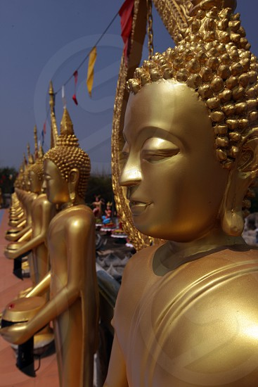 Golden Buddha near the city of Khorat in the Province of Nakhon Ratchasima in the Region of Isan in Northeast Thailand in Thailand.  photo