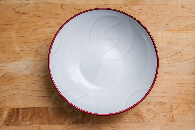 Empty plate on wooden able photo