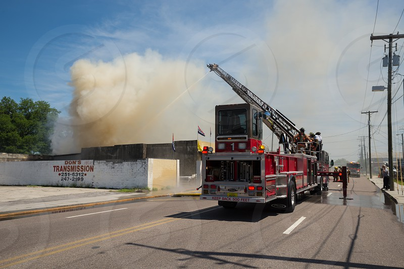 Ladder truck warehouse fire fire truck ladder smoke  photo