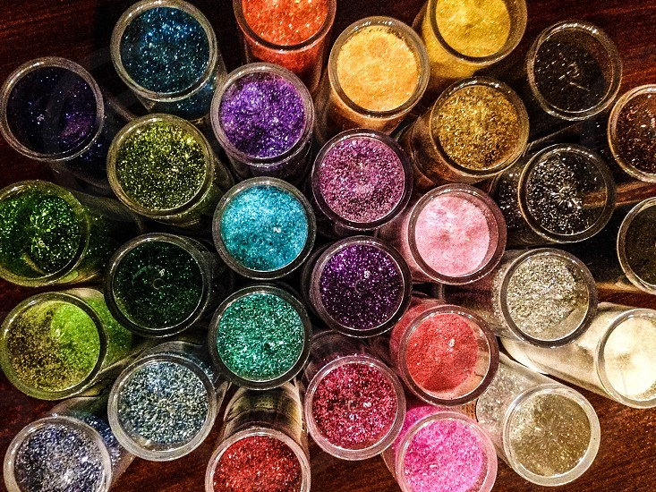 different colors of glitters on container photo