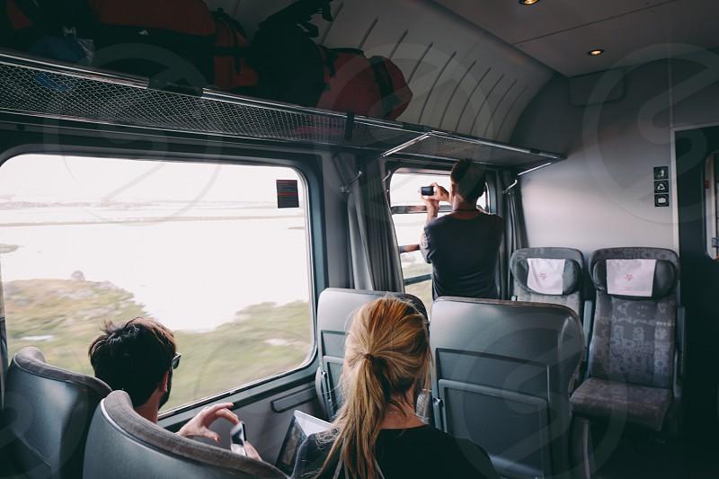 people seated on train seats photo