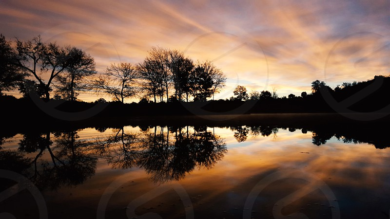 Scenic rural sunrise over water in Texas during winter season. photo