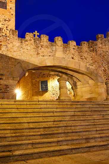 Caceres Arco de la Estrella Star arch sunset in Spain entrance to monumental city photo