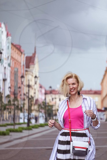 Happy woman in pink T-shirt  photo