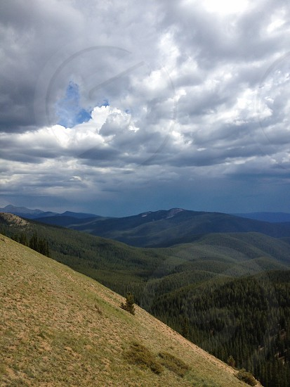 Mountain pass with storm clouds forming photo