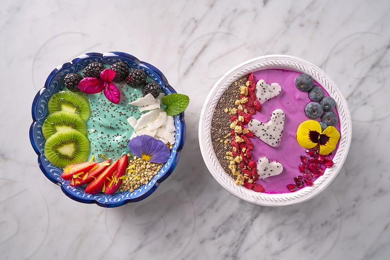 Acai bowl smoothie and Spirulina algae healthy breakfast with seeds and berries photo