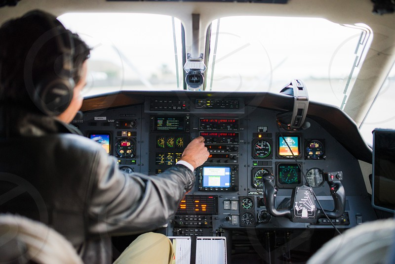man in black leather jacket driving plane photo