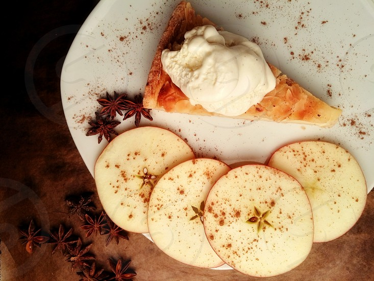Apple pie with cinnamon and vanilla ice cream on rustical backgroud photo