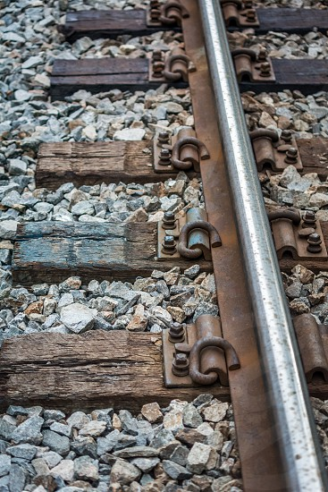 pattern repetition repeat texture railroad tracks rail board rock metal photo