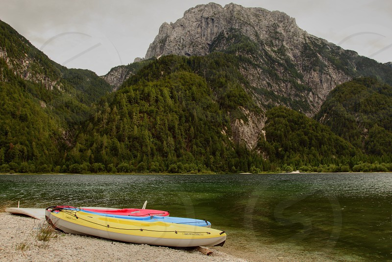 yellow red and blue kayak photo