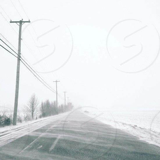 grey concrete road covered with snow photo