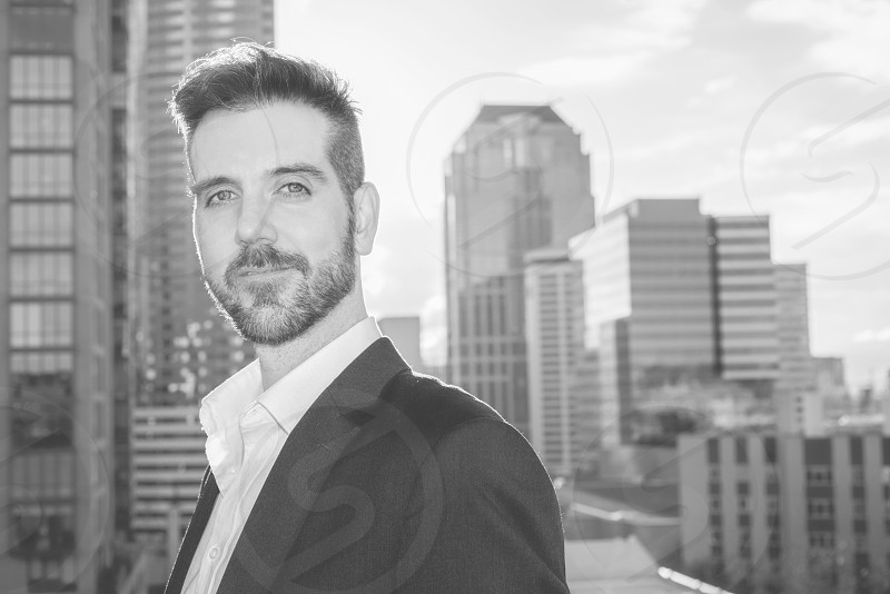 Handsome confident male business professional outside in black and white. photo