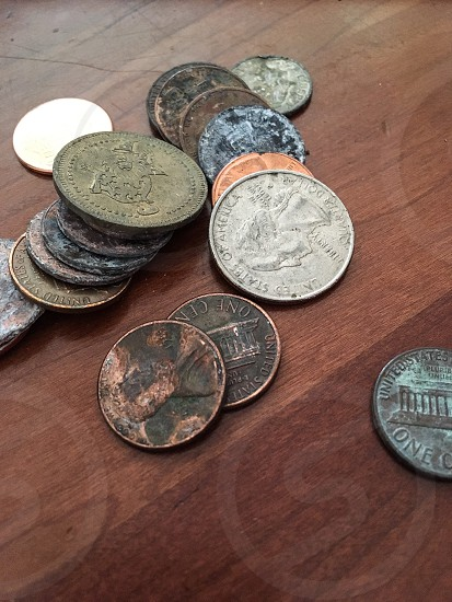 Personal banking - money found on the street.  Banking coins found table pennies quarter change spare change save photo