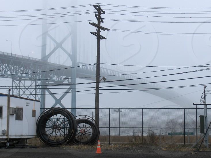 Ambassador Bridge Detroit/ Windsor foggy morning grungy industrial.  photo