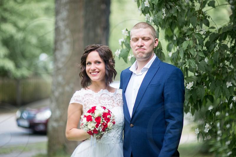 Amazing smiling wedding couple. Pretty bride and stylish groom. photo