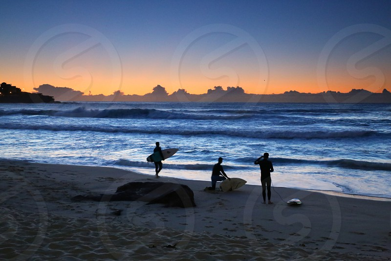 Surfers at beach photo