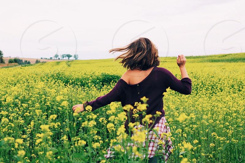 woman in yellow flower field photo