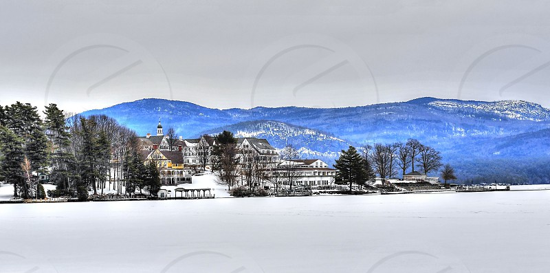 Snow scene across Lake George in New York with mountains. photo