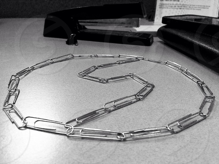 silver chained paper clips photo