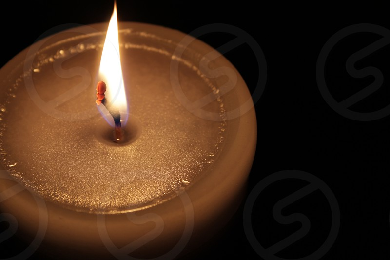 a golden candles wick macro. photo