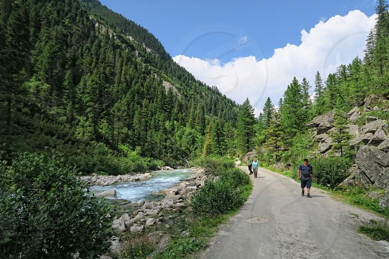 Krimml Tirol/ AUSTRIA July 29 2016: People hiking in the Krimml Achental valley at Krimml waterfalls in summer time. Part of High Tauern mountain range national park. (Austria) photo