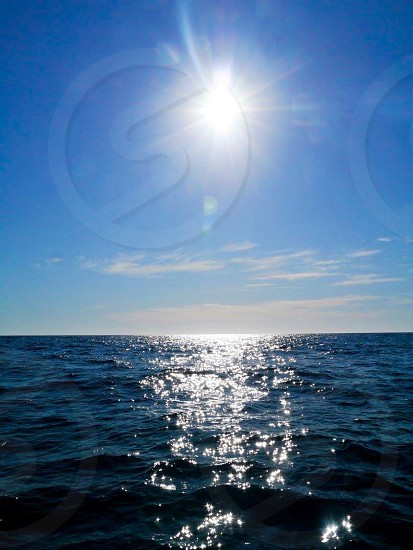 Sea sun shadow waves ocean blue peace freedom nature travel photo