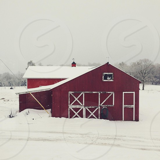 brown and white barn view during winter photo