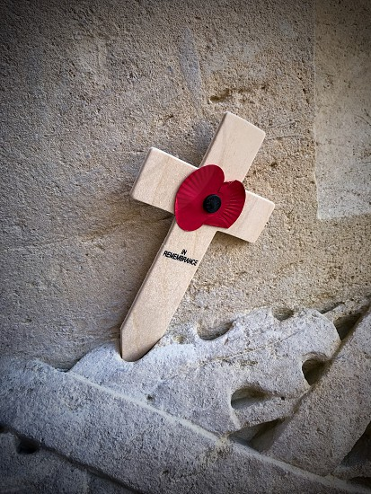 Outdoor day vertical portrait colour Thiepval France Somme western front Battle site battleground historic historical red poppy flowers remembrance commemoration monument respect stone WWI WW1 World War One First World War Memorial carved carving masonry  country crucifix cross photo