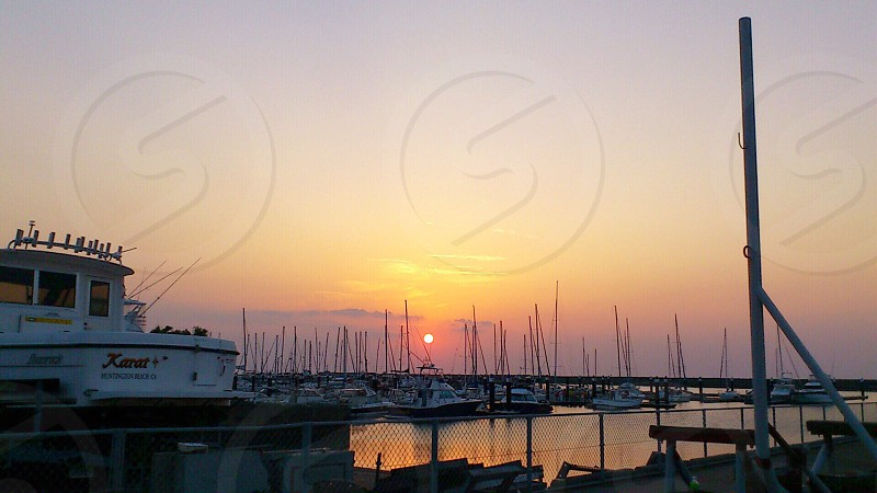 speed boats at dock during sunset photo