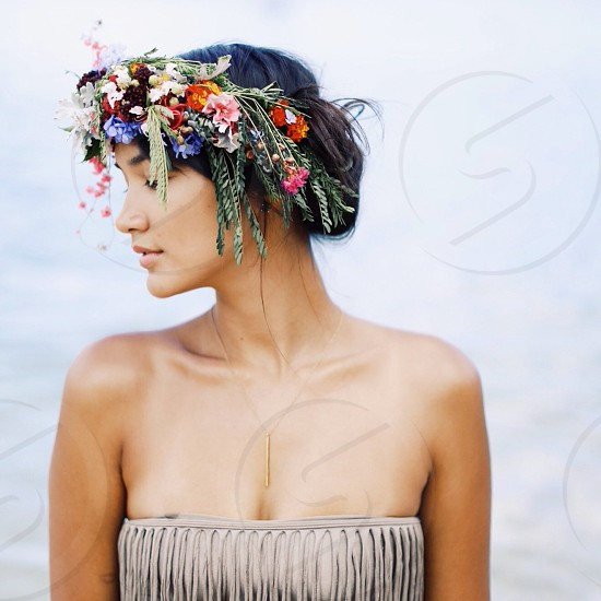 woman with flower and grass on head photograph photo