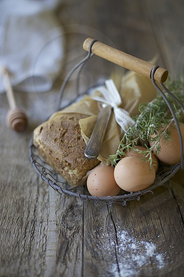 homemade bread farm fresh eggs and garden herbs photo