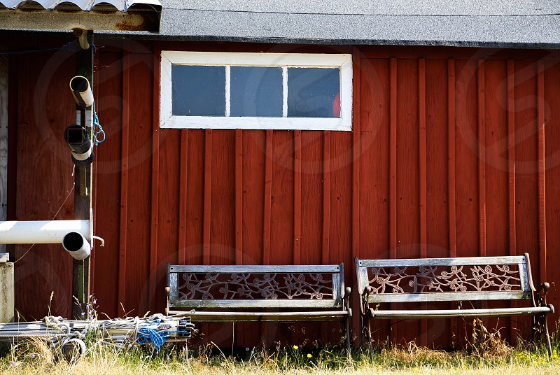 2 benches on house wall photo