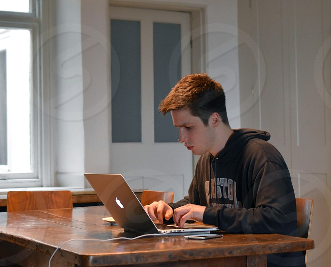 Student working on laptop computer. photo