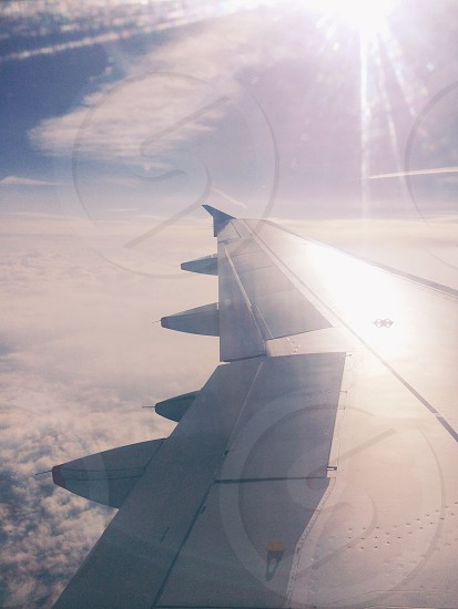 white and gray aircraft wing during day photo