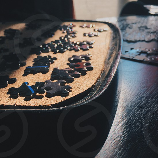 black puzzles on black wooden table photo
