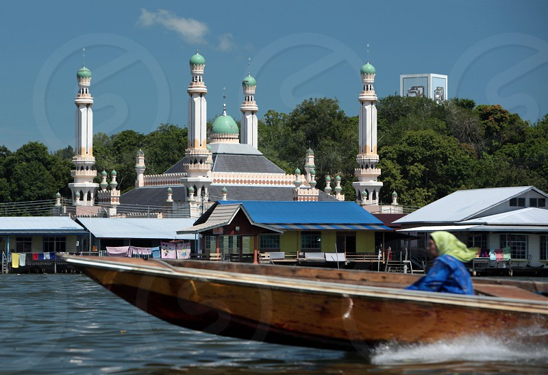 the water village and town of Kampung Ayer in the city of Bandar seri Begawan in the country of Brunei Darussalam on Borneo in Southeastasia. photo