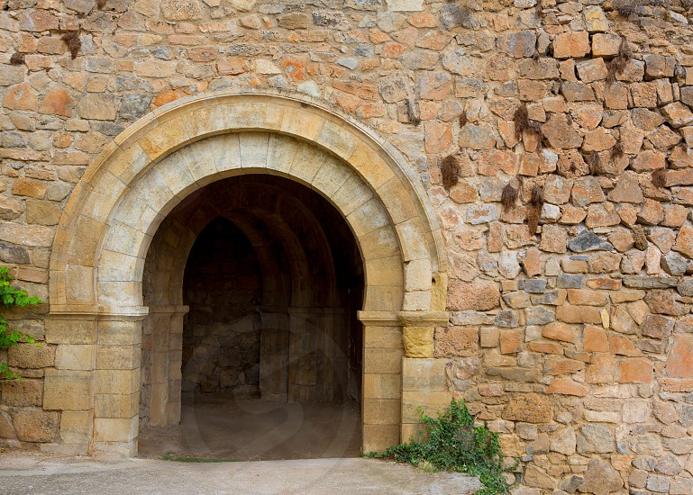 Canete Cuenca puerta de San Bartolome in stone masonry fort Spain Castilla La Mancha photo