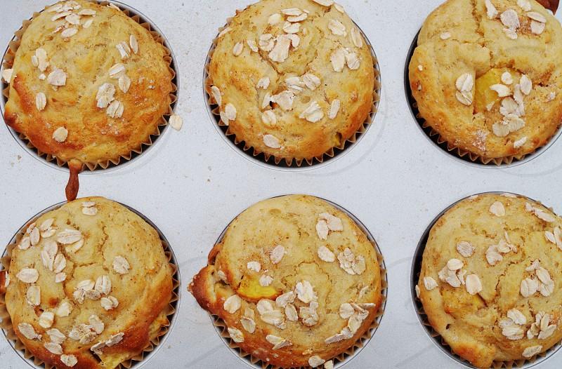 Baking oat muffins photo