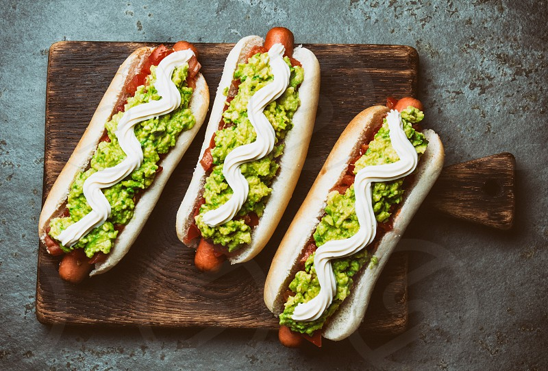 Chilean Completo Italiano. Hot dog sandwich with tomato avocado and mayonnaise. Top view copy space photo