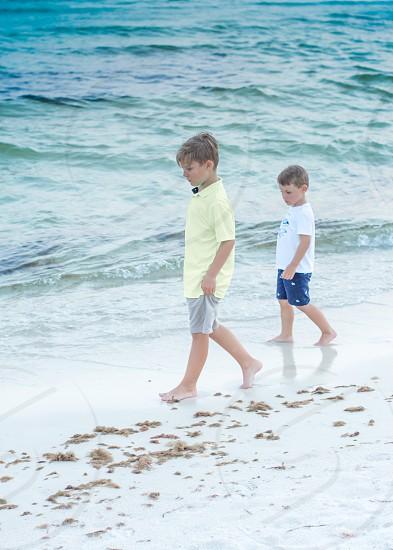 Boys on beach vacation travel exploring photo