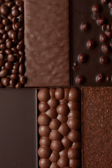 texture of various chocolate with nuts . Food background photo