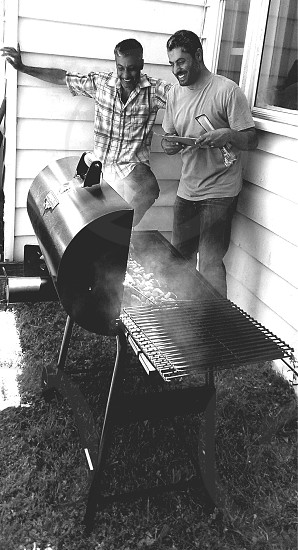 My father and uncle at the Family BBQ reminiscing about old times and old BBQ's. #brothers #family #memories photo