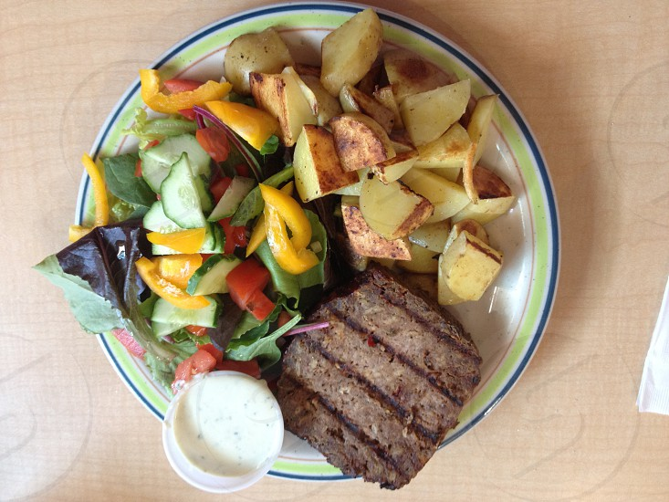 Grilled meatloaf salad and potatoes with dressing photo