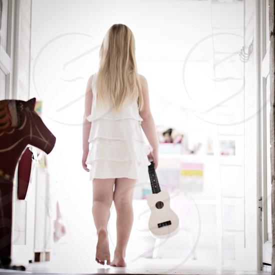 Walk away walk away... Guitar child rear view young girl horse  photo
