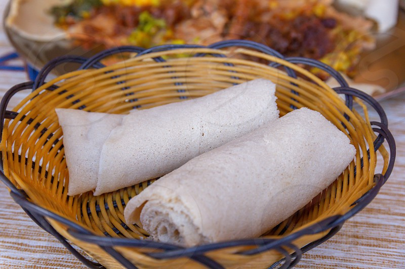 Rolls of Injera in a serving bowl.  Injera is a sourdough flatbread made from teff flour.  It is the national dish of Ethiopia Eritrea Somalia and Djibouti photo