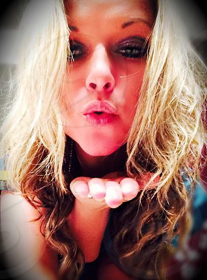 blonde woman blowing kiss photo