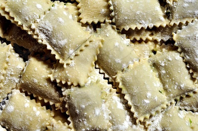 Homemade italian ravioli (fresh pasta) photo