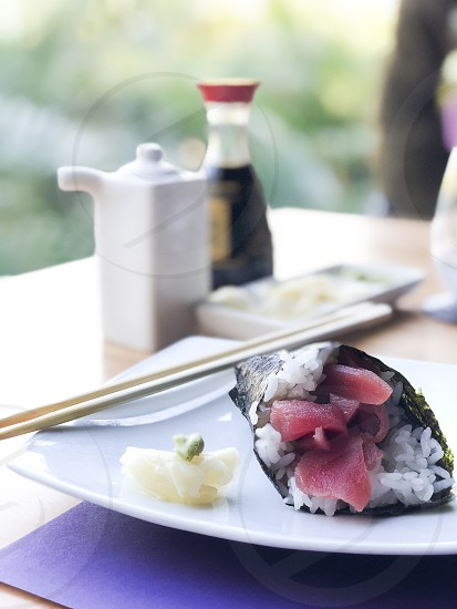 Tuna sushi handroll with sliced ginger and wasabi photo