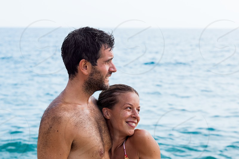 Young couple in love hugging at the beach photo