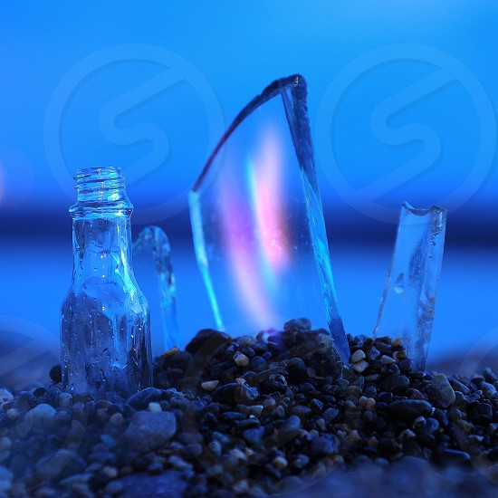 pieces of glass in rocks photo